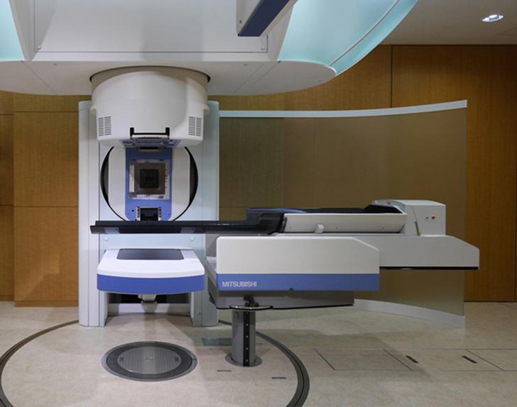 三菱電機,がん治療財団から「重粒子線スキャニング照射装置」を受注